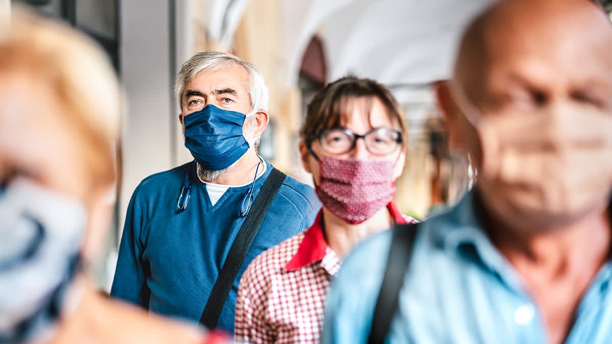 People wearing cloth face masks.