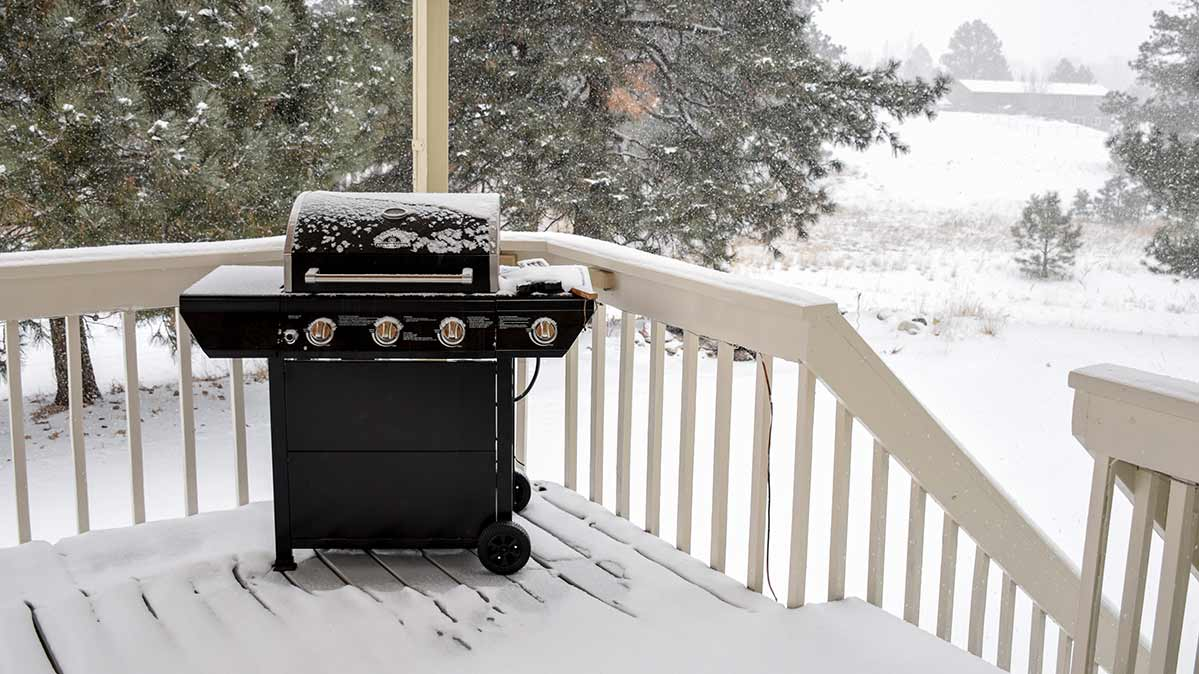 Cold-weather grilling on a snowy patio.