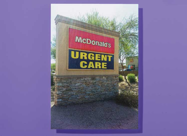 An outdoor retail area sign that lists a McDonald's restaurant and an urgent medical care clinic in the same location.