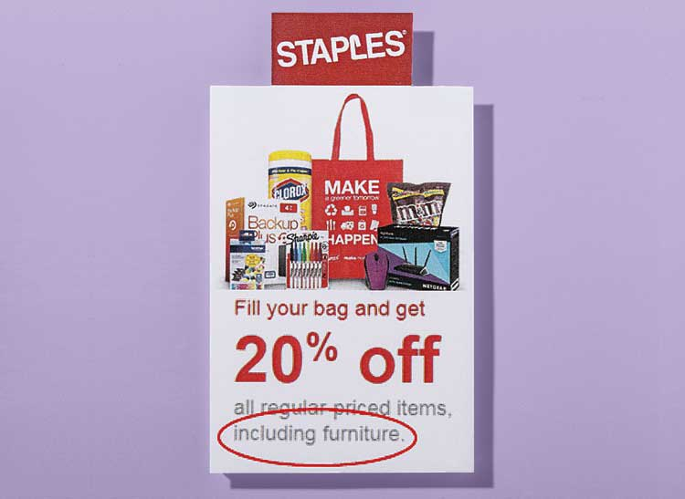 An ad from Staples office supply store that encourages shoppers to fill shopping bags with discount items, including furniture.