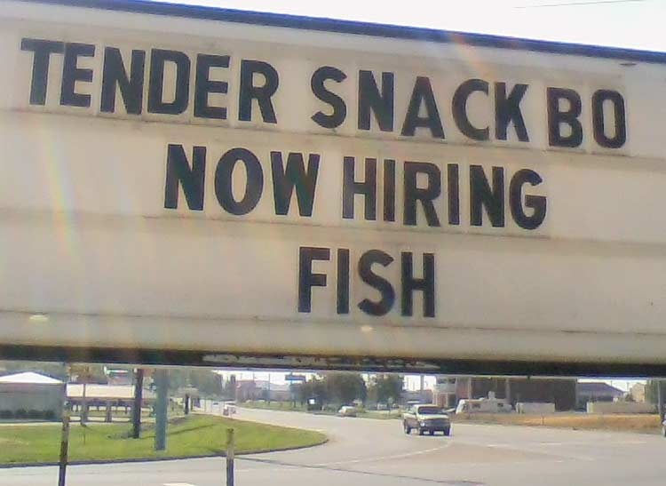 A photo of a restaurant marquee advertising it is now hiring fish.