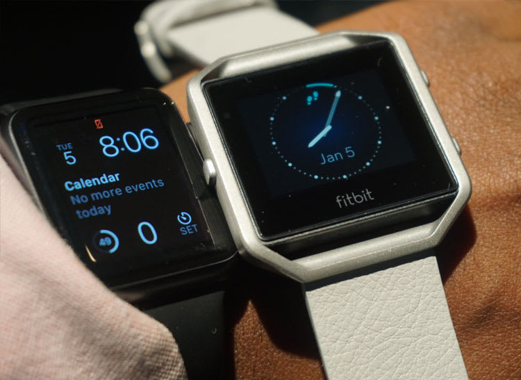 Gray Fitbit Blaze next to a black Apple Watch at CES 2016