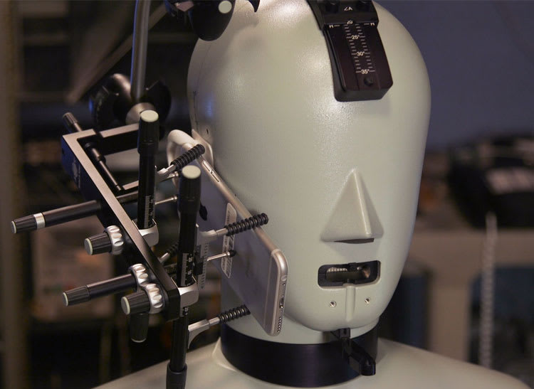 iPhone 6s testing. The head and torso simulator, which looks like the top half of a crash-test dummy, has