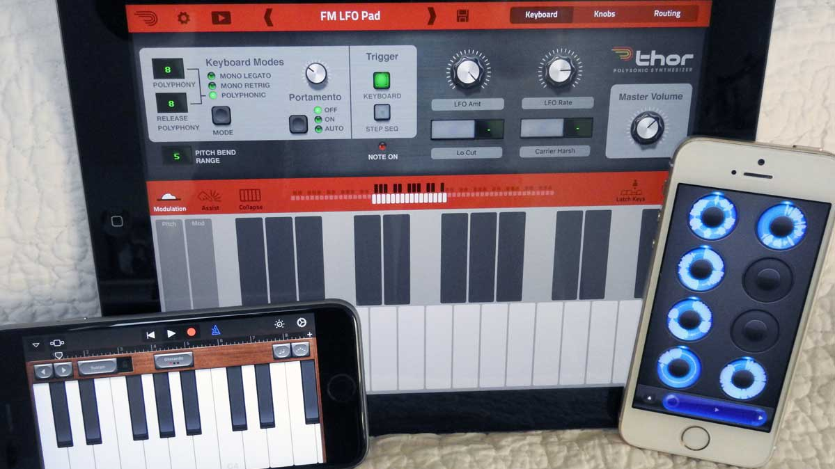 Two Apple iPhones and an iPad with music-creation apps.