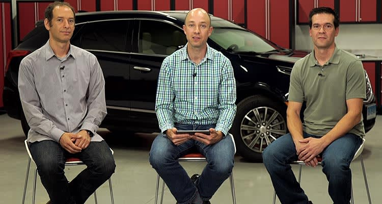 Jake Fisher, Jon Linkov, and Mike Monticello on set with the Cadillac XT5.