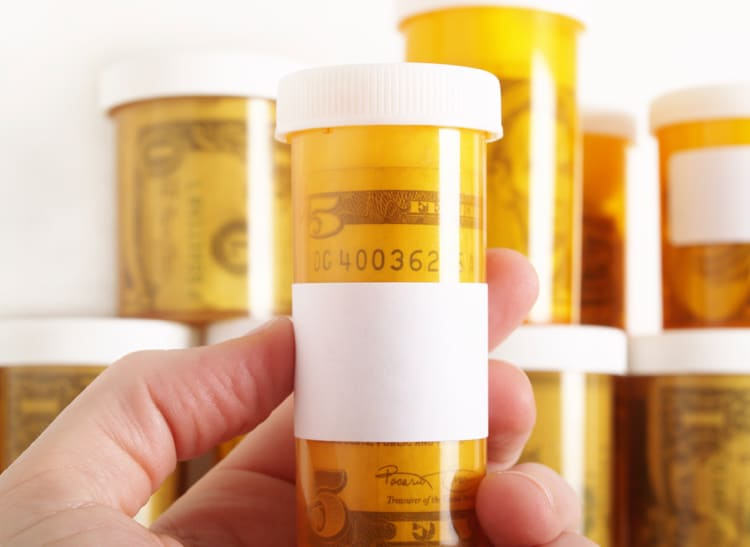 Statins cause diabetes. Image of money inside prescription pill bottle