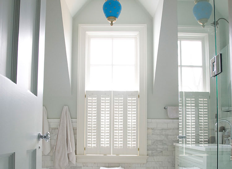 A white bathroom with blue fixtures.