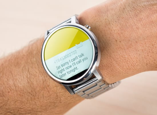 Someone checking a notification that just popped up on a smartwatch.