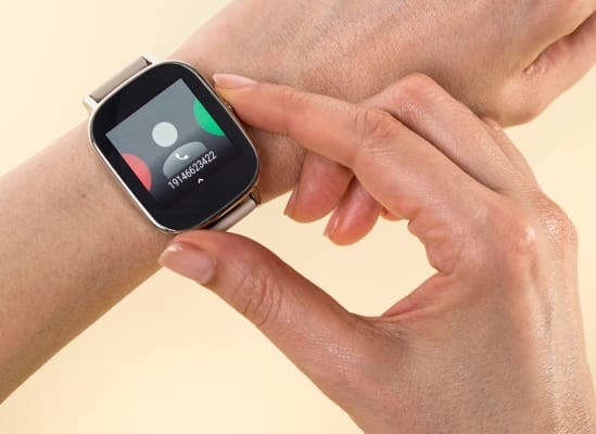 A person about to take an incoming call via a smartwatch.