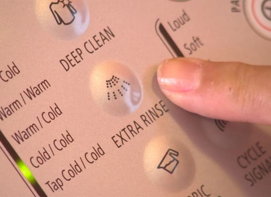 An extra rinse button on a washing machine control panel.