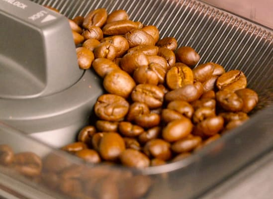 Whole beans in a built-in grinder's hopper.
