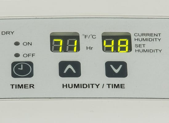 A control panel on a dehumidifier.