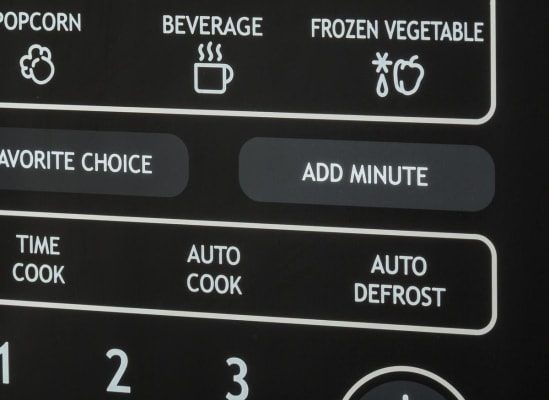 A 1-minute or quick key on a microwave control pad.