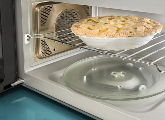 A pie on a microwave rack being browned with the convection setting. (For best results, we don't recommend this.)