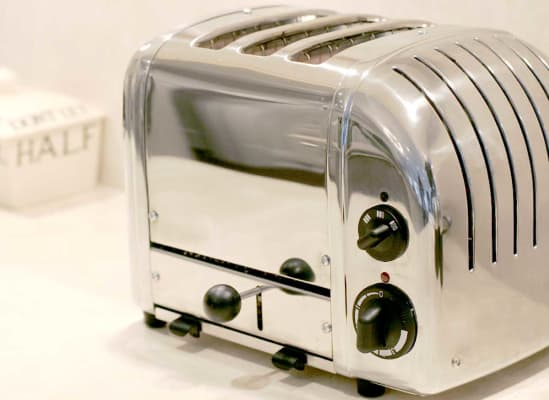 A toaster that has a bread lifter.
