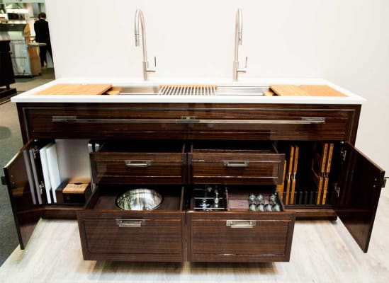 The Galley Dresser contains a sink, prep surfaces, and cabinet space.