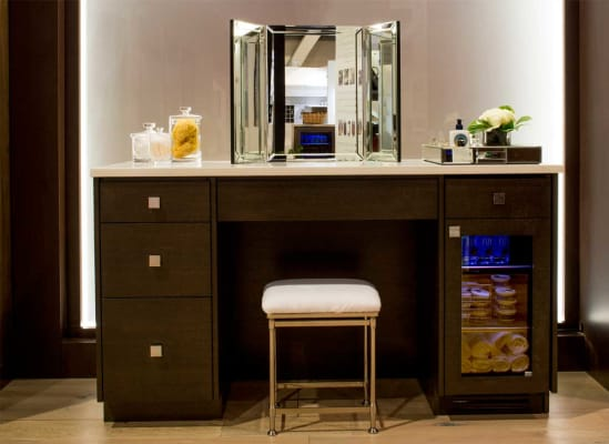 A compact refrigerator from True keeps makeup fresh