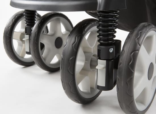 A set of stroller wheels and shock absorbers.