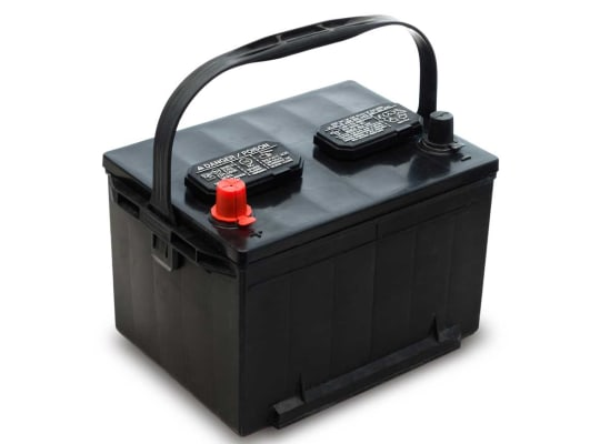 A car battery that has a handle.