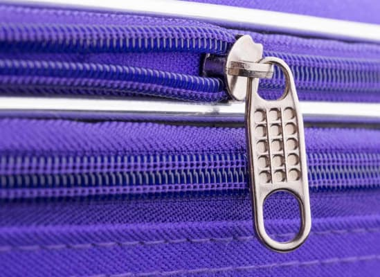 Photo of a suitcase zipper.