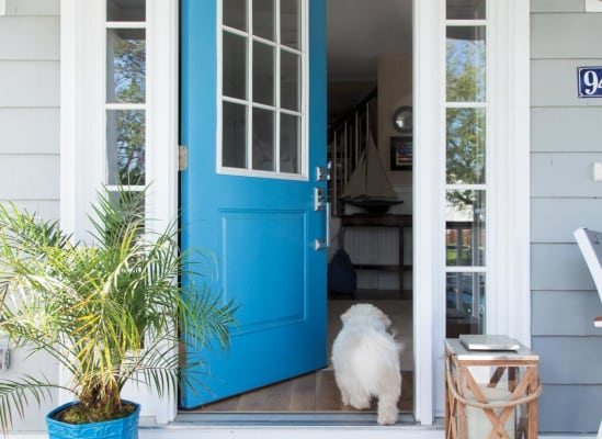 A bright front door with two paint colors.