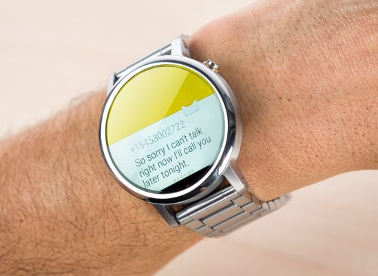 Someone checking a notification that just popped up on their smartwatch.