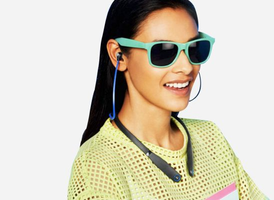 Woman wearing a headphones collar.