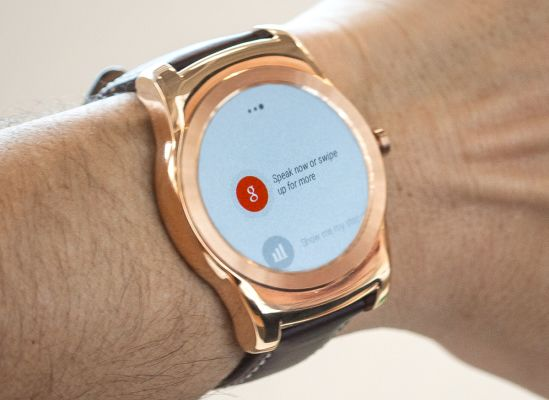 A person using the voice-command function on their smartwatch.
