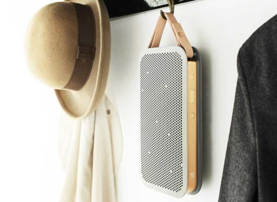 Photo of a Bang & Olufsen Beoplay A2 wireless speaker hanging from a coatrack.