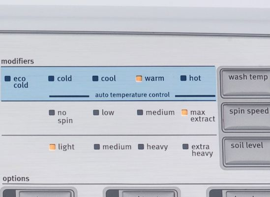 A close shot of automatic temperature controls on a washing machine.