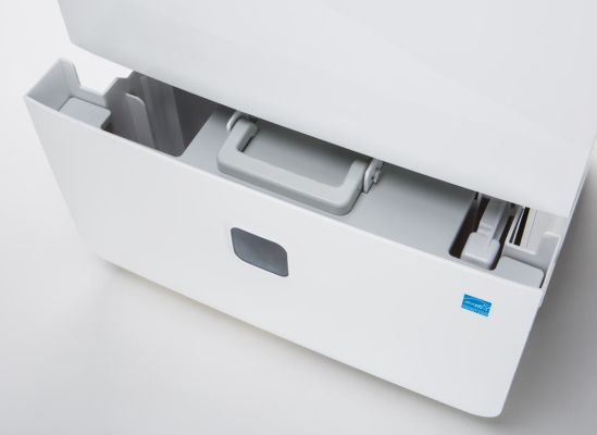 A removable dehumidifier tank that has a handle and a cover.