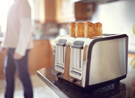 Photo of toast in a toaster that has been consistently browned.