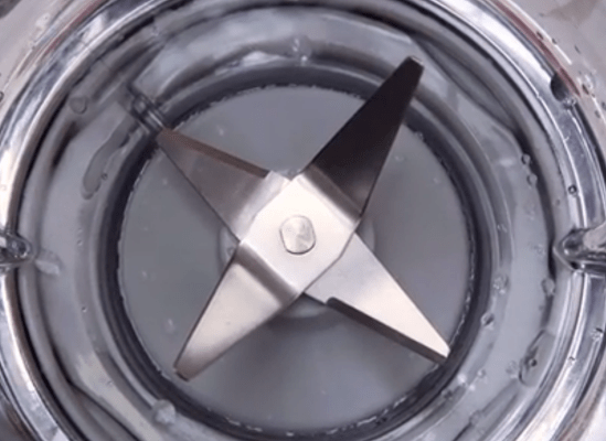 A picture of the blades inside a blender.