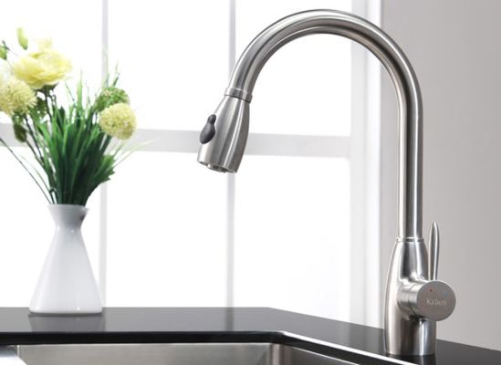 Photo of a kitchen faucet with a spray/stream selector.