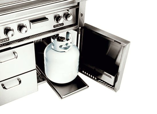 Picture of a pullout tray on a gas grill where a propane tank can sit.