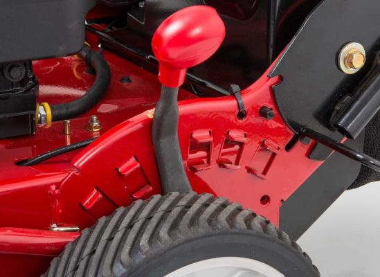 Picture of a one-lever height adjustment on a lawn mower.