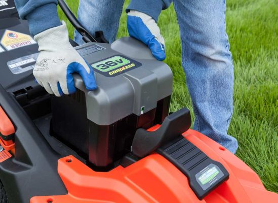 Picture of someone removing a battery on a lawn mower.