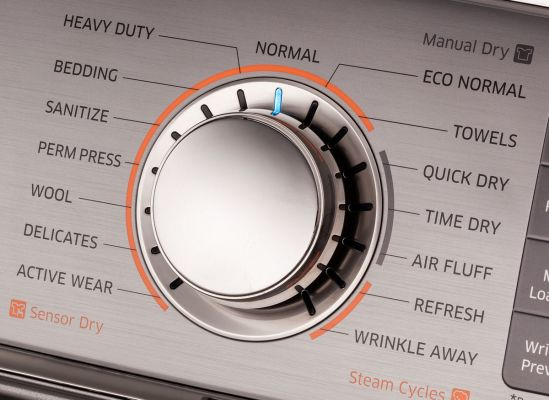 A close shot of auto-dry cycles on a clothes dryer dial.
