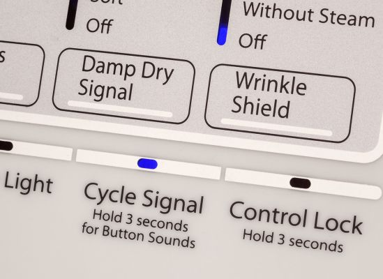 A close shot of an end-of-cycle signal, which lights up on a dryer's display panel.