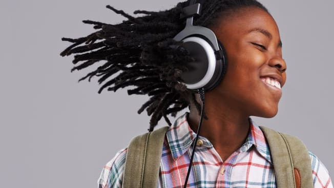 Young girl bobbing her head to the beat of the music.