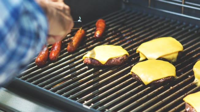Weber grill BBQ burgers and hot dogs