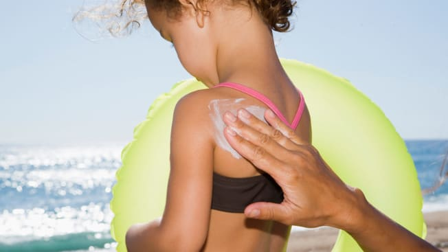 young child, daughter ,,mother, sunscreen beach