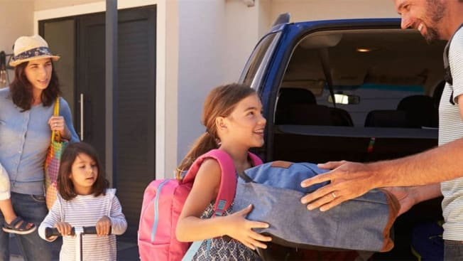 Family packing car ready for summer vacation.