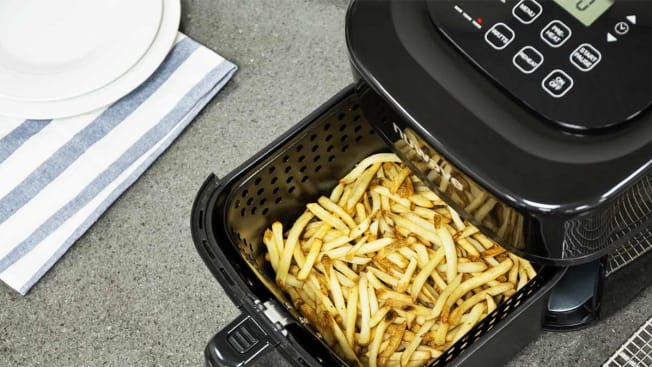 NuWave 37001 air fryer with open tray of fries on counter