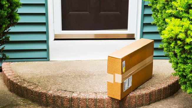 Package delivered to front door of home.