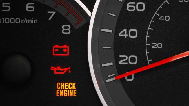 Check engine light on car dashboard