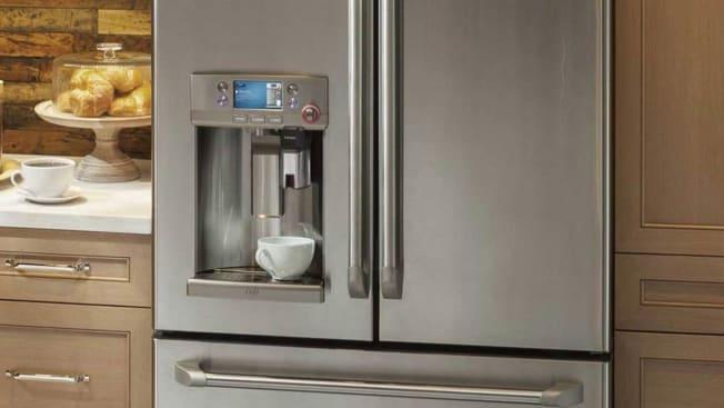 Counter-depth refrigerator seen in a kitchen.