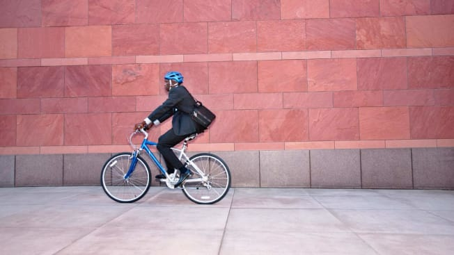 person riding bicycle to work