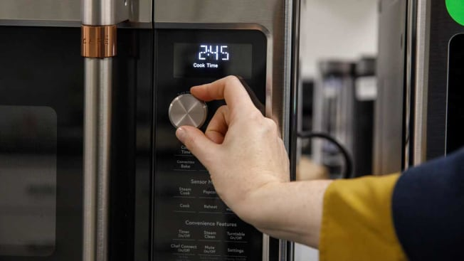 Hand turning microwave dial
