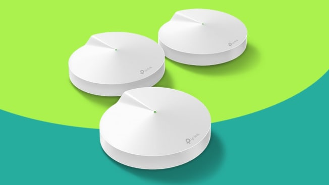 Three TP-Link routers on green background